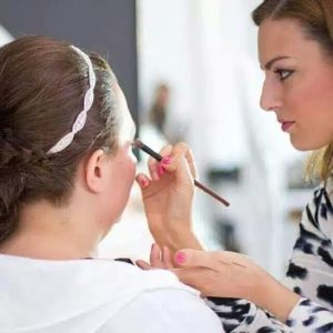 Photo of Maria Gatto, right doing a clients makeup for a wedding. Photo taken by the wedding photographer, Ms. Gatto do not recall his name.