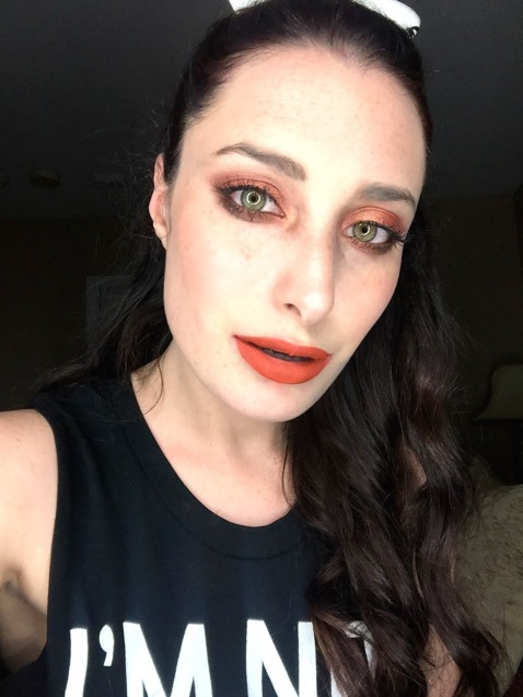 fall makeup look with orange shadows